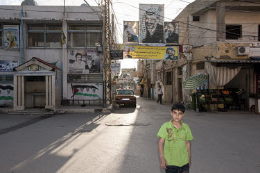A large portrait of Yasser Arafat displayed across a street in the Al Buss Palestinian refugee camp. It was established in 1939 during the French mandate to shelter refugees from Armenia. In 1948 and...