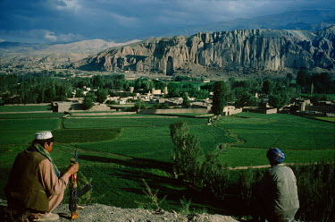 An armed Hazara fighter from the Hesbe-Wahdat-e Islami political group near the site of the Bamiyan Buddha statues (6th-7th century CE) prior to their destruction by the Taliban in 2001.