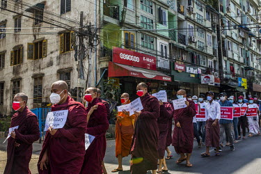 Buddhist monks demonstrating in support of democracy, Aung San Suu Kyi and the National League for Democracy (NLD), and to protest the 1 February 2021 military coup.