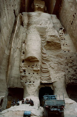 Hazara fighters, from the Hesbe-Wahdat-e Islami political group, gathered beneath the 'Western' Bamiyan Buddha (6th-7th century CE), one of two giant rock-carved Buddha statues , prior to their destru...