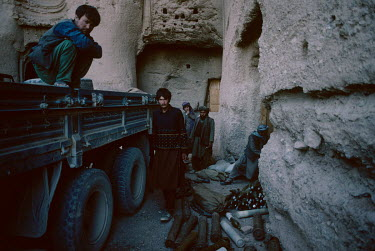 Hazara fighters, from the Hesbe-Wahdat-e Islami political group, with ammunition they store in caves at the site of the 'Western' Bamiyan Buddha (6th-7th century CE), one of two giant rock-carved Budd...