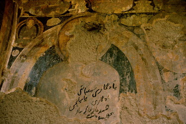 Arabic script graffiti scrawled on Buddhist frescoes on the walls that surrounded the giant Bamiyan Buddha statues (6th-7th century CE) prior to their destruction by the Taliban in 2001.