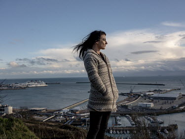 Kay, a volunteer for Channel Rescue, looks out to sea from a vantage point above the port at Dover.
