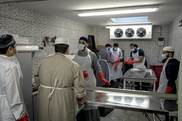 Volunteers working for bereavement charity Supporting Humanity, prepare to wash the body of a COVID-19 victim at a mosque in East London.