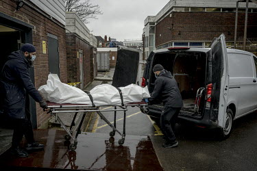 A body is collected from a morgue in south london by volunteers from bereavement charity Supporting Humanity.