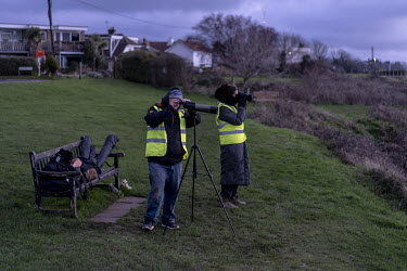 Volunteers from Channel Rescue prepare to scan the English Channel, using binoculars and telescopes, as they search for refugees making the crossing from France.