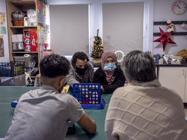 Bridget Chapman (R), from the Kent Refugee Action Network, plays games during a lesson with a group of teenage refugees from Syria, Eritrea and Iran.