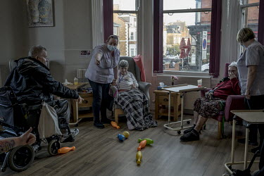 Staff members play games with residents at St Cecilia's nursing home. During the first wave residents died after being infected by COVID-19 patients being transferred to the home from hospital without...