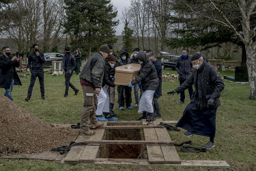 A coffin containing the body of Shamim Azhar (58) is carried to his grave. Azhar died at home and his body lay undiscovered for two months as England progressed through various levels of COVID-19 rest...