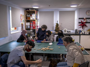 Bridget Chapman (front right) and a colleague, from the Kent Refugee Action Network, plays games during a lesson with a group of teenage refugees from Syria, Eritrea, Chad and Iran.