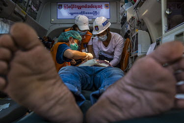 Rescue workers in an ambulance inside a monastery compound treat Ko Shein who was injured in the head after security forces using slingshots fired into the Mya Taung monastery compound where Buddhist...