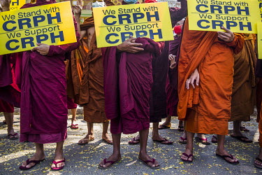 Buddhist monks from Mya Taung monastery protest against the military coup. They are carrying placards declaring their support for the legitimate government of Myanmar.
