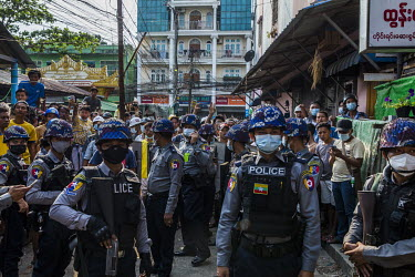 Police arrive on the scene after local residents say they were attacked by a group of pro-military thugs, including monks, from a monastery known to be linked to the ultra-nationalist Patriotic Associ...