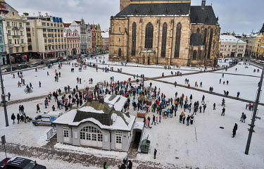 People visit Republic Square (Namesti republiky) to look at a display of ice sculptures, despite the ban on gatherings due to coronavirus restrictions.