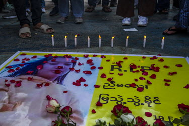 Protestors place roses at a memorial to Mya Thwet Thwet Khaing, a young woman who was shot in the head by the security forces in Naypyitaw on 9 February 2021 and died in hospital ten days later.