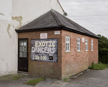 A sign advertises 'Exotic Dancers' on the exterior of the Prince of Wales Pub in Rickmansworth, a town just outside London.