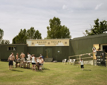 Members of the Roding Valley cricket club gather outside midway through the England football team's 4-1 defeat to Germany in the 2010 Football World Cup.