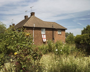 England's national flag, the George Cross, hangs from the window of a residential home. On this day, England were defeated 4-1 by Germany in the 2010 Football World Cup.