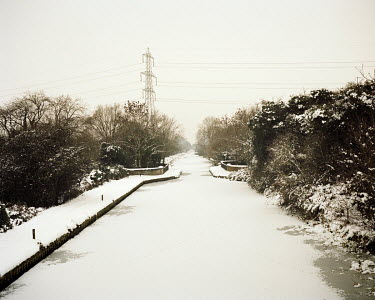 Winter ice and snow cover the Grand Union Canal in Uxbridge.