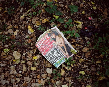 An abandoned copy of the Sunday Sport, a British tabloid newspaper.