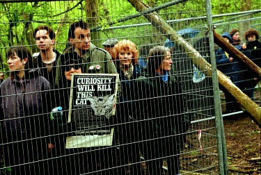 Animal rights protestors are kept away from Hillgrove Cat Farm by wire fencing.