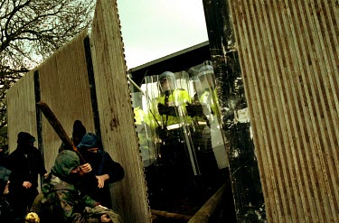 Riot Police wait as animal rights demonstrators break through the fences surrounding Hillgrove Cat Farm.