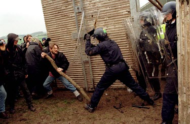 Riot police try to prevent protesters entering Hillgrove Cat farm during an anti-vivisection demonstration.