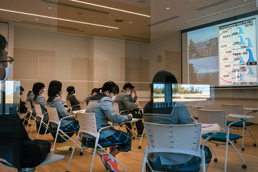 A group of school children and their teacher listen to a lecture about the 2011 tsunami at The Great East Japan Earthquake and Nuclear Disaster Memorial Museum.  The entire population of Futaba was ev...