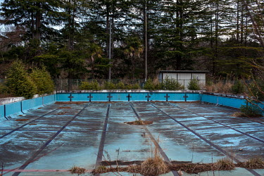 The swimming pool of a school abandoned since March 2011 due to elevated radiation levels.  The entire population of Futaba was evacuated en masse after the Fukushima Daiichi nuclear disaster. Since 2...