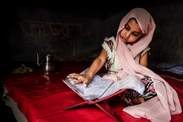 A girl reads a religious text in the urban refugee camp popularly known as 'Geneva Camp'. The people living in the area are related to Muslims who moved here mostly, but not exclusively, from Bihar in...