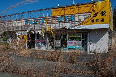 A books and video store damaged by the 2011 earthquake and abandoned since March that year due to elevated radiation levels.  The entire population of Futaba was evacuated en masse after the Fukushima...