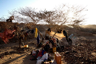 Workers washing in a rough makeshift camp at the Tabelote gold mine.