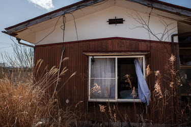 A house abandoned since March 2011 due to elevated radiation levels.  The entire population of Futaba was evacuated en masse after the Fukushima Daiichi nuclear disaster. Since 2013, only 4% of the to...