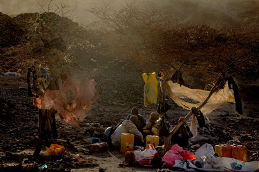 Workers in a rough makeshift camp at the Tabelote gold mine.