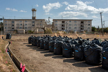 Plastic bags containing contaminated waste stored near a public housing estate abandoned since March 2011 due to elevated radiation levels.  The entire population of Futaba was evacuated en masse afte...