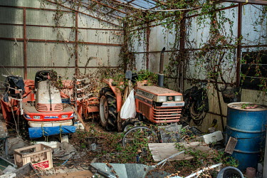 Machinery in a farm abandoned since March 2011 due to elevated radiation levels.  The entire population of Futaba was evacuated en masse after the Fukushima Daiichi nuclear disaster. Since 2013, only...
