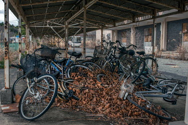 A pile of bicycles left outside an abandoned high school that has been disused since March 2011 because of elevated radiation levels.  The entire population of Futaba was evacuated en masse after the...