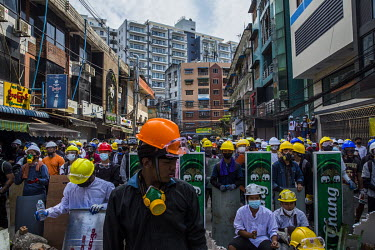 Protestors wearing hard hats, goggles and face masks, and some with home made shields, as they try to protect themselves from the tear gas being used against them by the security forces during anti-co...