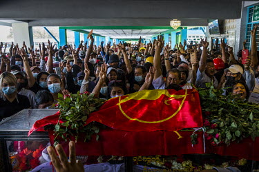 Mourners raise their hands in protest at a funeral service for three of the six people killed two days earlier when the military and police joint security forces used live fire on anti-coup protestors...