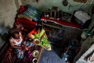 A couple eat together in a small room in the urban refugee camp popularly known as 'Geneva Camp'. The people living in the area are related to Muslims who moved here mostly, but not exclusively, from...