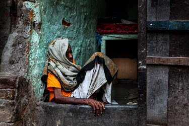 An elderly woman sleeping in a doorway in the urban refugee camp popularly known as 'Geneva Camp'. The people living in the area are related to Muslims who moved here mostly, but not exclusively, from...
