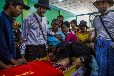 [NOTE: Please do not credit photographer] YANGON - March 5, 2021: Relatives mourn beside the dead body of Zwe Htet Soe, 26, who was shot to the head two days ago when the military and police joint sec...