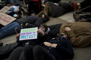 A mass lie down during a protest in Parliament Square, held in response to the heavy-handed policing of a vigil, held the previous night in memory of the murdered Sarah Everard.