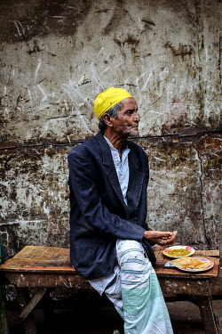 An elderly man eats in the urban refugee camp popularly known as 'Geneva Camp'. The people living in the area are related to Muslims who moved here mostly, but not exclusively, from Bihar in India aft...