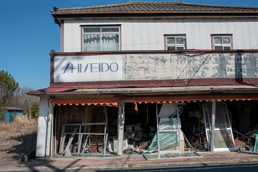 A shop damaged by the earthquake and abandoned since March 2011 due to elevated radiation levels.  The entire population of Futaba was evacuated en masse after the Fukushima Daiichi nuclear disaster....