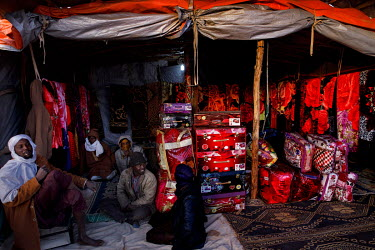 People selling blankets and cases at the 'Cassoua Dunia' (world market) at the Tagharaba gold mine.