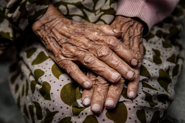 A elderly woman's wrinkled hands in the urban refugee camp popularly known as 'Geneva Camp'. The people living in the area are related to Muslims who moved here mostly, but not exclusively, from Bihar...