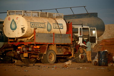 A truck converted to carry a water tanker which it delivers to the parched Tagharaba gold mine.