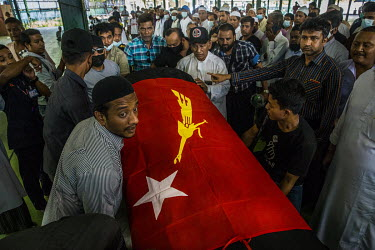 Friends and relatives carry the coffin, wrapped in National League for Democracy flag, of U Khin Maung Latt (58), a local NLD leader at his funeral service. According to a Facebook post made by the el...