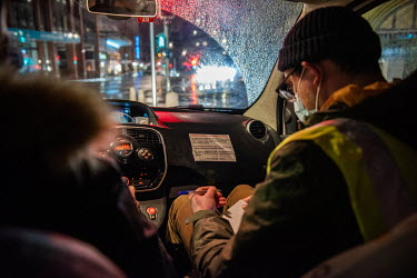 Members of an emergency winter night team, social workers from the Ville de Geneve, on a late night outreach tour in support of homeless people in the town.